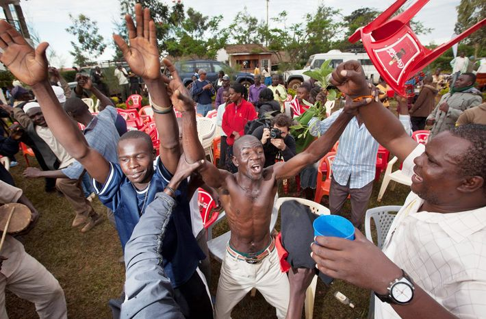Villagers at an all-night party in Kogelo, Kenya, who gathered to watch TV coverage of the U.S. presidential election, celebrate after the result was called in favor of President Obama. Kogelo is the home of Sarah Obama, his stepgrandmother. (Associated Press)