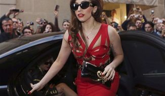 **FILE** Lady Gaga arrives Oct. 1, 2012, at the Versace atelier in Milan, Italy. (Associated Press)