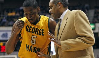 George Mason head basketball coach, Paul Hewitt, right, talks with forward Jonathan Arledge (5) during the first half of an NCAA Colonial Athletic Association semifinal college basketball game in Richmond, Va., Sunday, March 4, 2012. (AP Photo/Steve Helber)