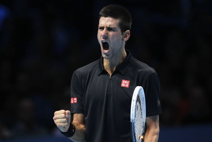 Novak Djokovic of Serbia reacts to a game win against Andy Murray of Britain during their ATP World Tour Finals singles tennis match at the O2 Arena in London, Wednesday, Nov. 7, 2012. (AP Photo/Sang Tan)