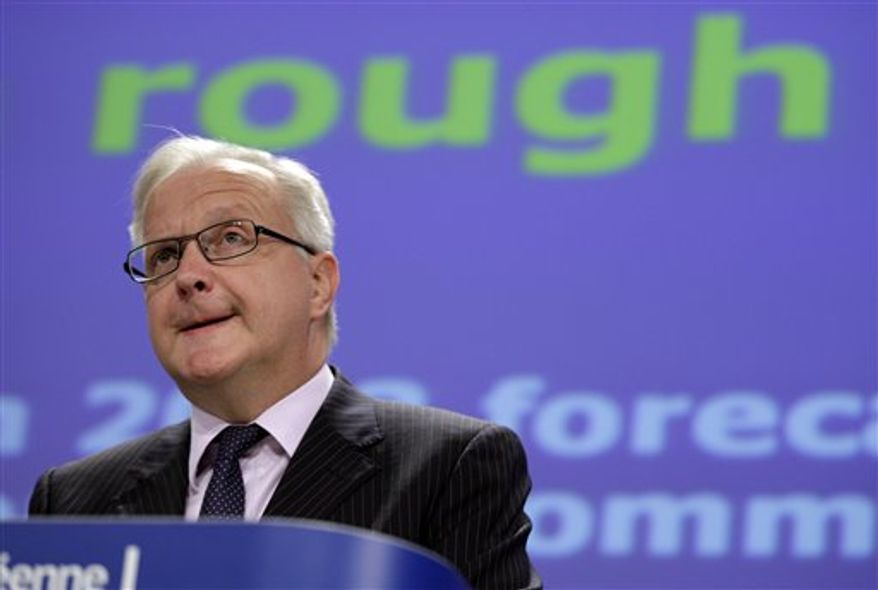 European Commissioner for Economic and Monetary Affairs Olli Rehn speaks during the presentation of the Fall Economic Forecast at EU headquarters in Brussels on Wednesday, Nov. 7, 2102. Europe's economy is still reeling and unemployment could remain high for years in spite of the progress made in solving the debt crisis, the European Union warned Wednesday as it downgraded its forecasts for the 27-country bloc. (AP Photo/Virginia Mayo)