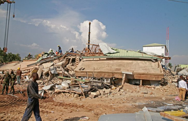 Workers search the debris of a collapsed five-story shopping center in Accra, Ghana, on Wednesday, Nov. 7, 2012. (AP Photo/Christian Thompson)