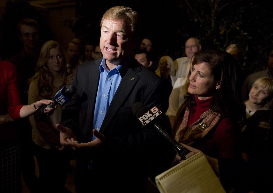 Sen. Dean Heller, Nevada Republican, talks to the media after winning re-election to the Senate over Rep. Shelley Berkley, his Democratic challenger, on Wednesday, Nov. 7, 2012, in Las Vegas. At right is his wife, Lynne. (AP Photo/Julie Jacobson)