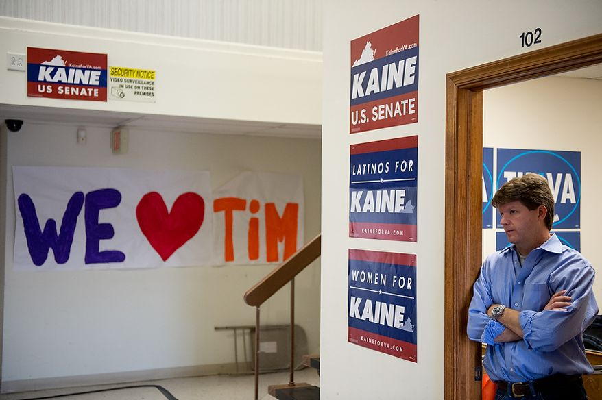 Kaine Campaign Manager Mike Henry watches as Virginia Senator Elect Tim Kaine (D) speaks at a press conference at Kaine for Virginia's Richmond headquarters the day after after winning the election, Richmond, Va., Wednesday, November 7, 2012. (Andrew Harnik/The Washington Times)
