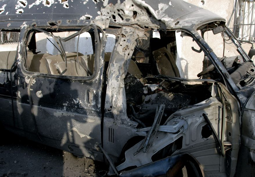 This photo released by the Syrian official news agency SANA shows a damaged vehicle at the scene after an attack in Damascus, Syria, on Nov. 7, 2012. (Associated Press/SANA)