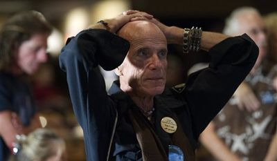 Dennis Eugene Hatton reacts while watching televised reports on the presidential election at an Obama watch party in Fort Myers, Fla., Tuesday, Nov. 6, 2012. (AP Photo/J Pat Carter)