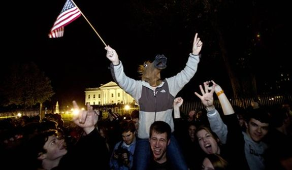 People celebrate outside of White House on Pennsylvania Avenue after President Barack Obama won re-election against Mitt Romney in the presidential election in Washington, Wednesday, Nov. 7, 2012. (AP Photo/Jacquelyn Martin)