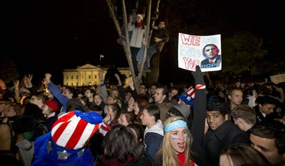 "Kelly Rodgers, 18, of Philadelphia, holds a sign saying ""We Will Barack You"" as people celebrate outside of the White House after President Barack Obama won re-election against Mitt Romney in the presidential election on Pennsylvania Avenue in Washington, Wednesday, Nov. 7, 2012. (AP Photo/Jacquelyn Martin)"