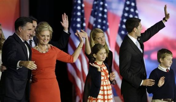 Republican presidential candidate and former Massachusetts Gov. Mitt Romney and his wife Ann, left, and Republican vice presidential candidate, Rep. Paul Ryan, R-Wis., and his wife Janna, right, are joined by their families on stage after Romney conceded the race during his election night rally, Wednesday, Nov. 7, 2012, in Boston. (AP Photo/David Goldman)