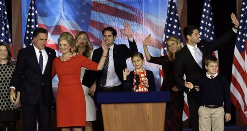 Republican presidential candidate and former Massachusetts Gov. Mitt Romney and his wife Ann, left, and Republican vice presidential candidate, Rep. Paul Ryan, R-Wis., and his wife Janna, right, are joined by their families on stage after Romney conceded the race during his election night rally, Wednesday, Nov. 7, 2012, in Boston. (AP Photo/Elise Amendola)