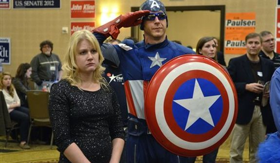 "Jon "" Captain America"" Angell salutes as Republican Presidential candidate Mitt Romney concedes the election to Democratic Presidential candidate Barack Obama at the Minnesota Republican election headquarters, Tuesday, Nov. 6, 2012, in Bloomington, Minn. (AP Photo/Tom Olmscheid)"
