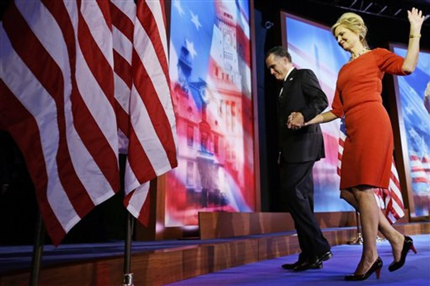Republican presidential candidate and former Massachusetts Gov. Mitt Romney walks off stage with his wife Ann Romney after he arrives gave his concession speech at his election night rally in Boston, Wednesday, Nov. 7, 2012. (AP Photo/Charles Dharapak)