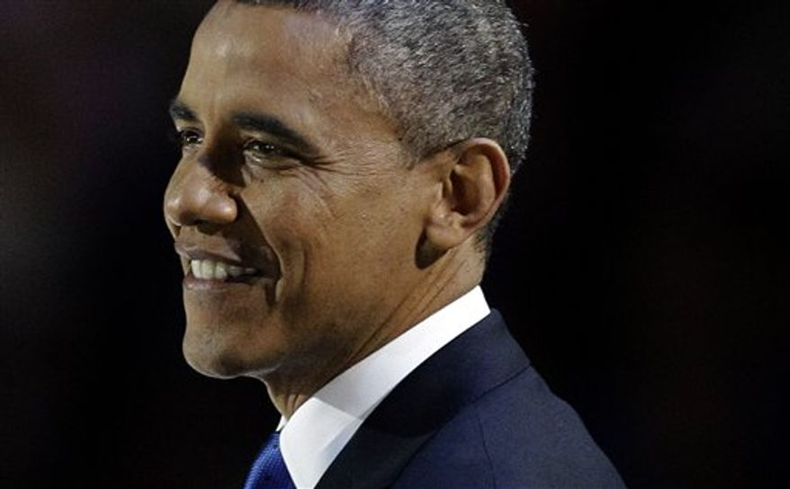 President Obama smiles during his speech at his election night party on Nov. 7, 2012, in Chicago. The president defeated Republican challenger Mitt Romney. (Associated Press)