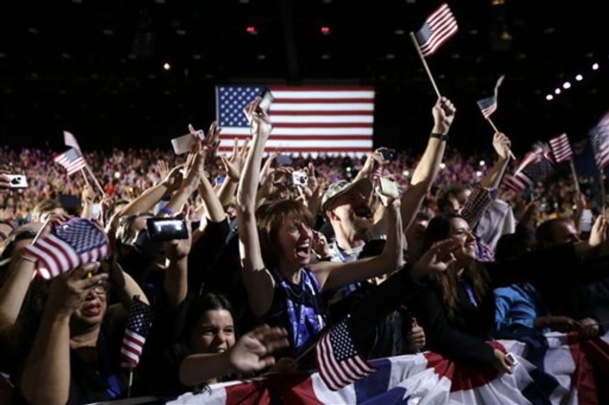 Supporters cheer as President Barack Obama speaks during an election night party, Wednesday, Nov. 7, 2012, in Chicago. Obama defeated Republican challenger former Massachusetts Gov. Mitt Romney.  (AP Photo/Matt Rourke)