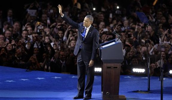 President Barack Obama waves at his election night party Wednesday, Nov. 7, 2012, in Chicago. President Obama defeated Republican challenger former Massachusetts Gov. Mitt Romney. (AP Photo/Nam Y. Huh)