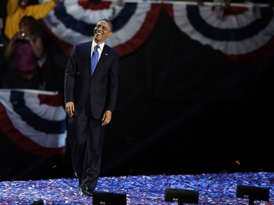 President Barack Obama smiles at his election night party Wednesday, Nov. 7, 2012, in Chicago. President Obama defeated Republican challenger former Massachusetts Gov. Mitt Romney. (AP Photo/Chris Carlson)