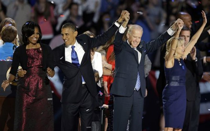 President Barack Obama, first lady Michelle Obama, Vice President Joe Biden and Jill Biden wave at his election night party Wednesday, Nov. 7, 2012, in Chicago. President Obama defeated Republican challenger former Massachusetts Gov. Mitt Romney. (AP Photo/Chris Carlson)