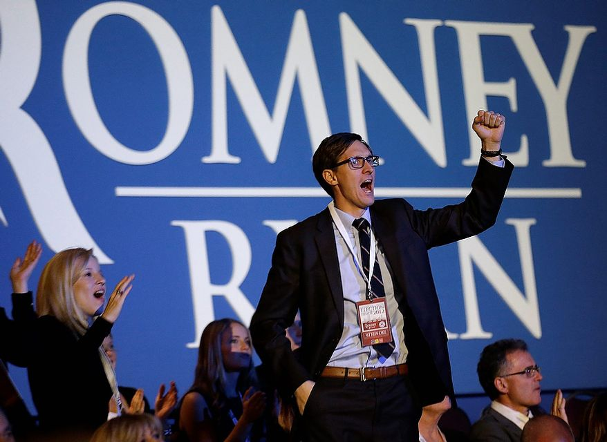 A spectator reacts to a change in the Florida early projections sen on a television during Republican presidential candidate and former Massachusetts Gov. Mitt Romney's election night rally, Tuesday, Nov. 6, 2012, in Boston. (AP Photo/David Goldman)