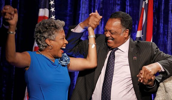 Former Democratic state Rep. Joyce Beatty, left, celebrates with Rev. Jesse Jackson at the Ohio Democratic party election night celebration  Tuesday, Nov. 6, 2012, in Columbus, Ohio. Beatty was elected in the newly drawn 3rd Congressional District. (AP Photo/Tony Dejak)