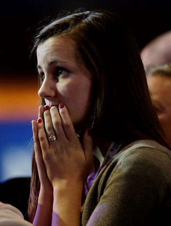 Sixteen-year-old Aly Hansen, from Amherst, N.H. watches vote results displayed on a television screen during Republican presidential candidate and former Massachusetts Gov. Mitt Romney's election night rally, Tuesday, Nov. 6, 2012, in Boston. (AP Photo/David Goldman)