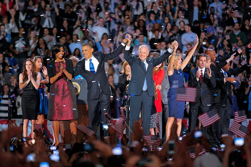 President Barack Obama and wife Michelle is holds hands with Vice President Joe Biden and his wife Jill following Obama's victory speech to supporters in Chicago early Wednesday, Nov. 7 2012. (AP Photo/Jerome Delay)