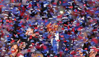 President Barack Obama smiles after delivering his victory speech to supporters gathered in Chicago early Wednesday Nov. 7 2012. (AP Photo/Jerome Delay)