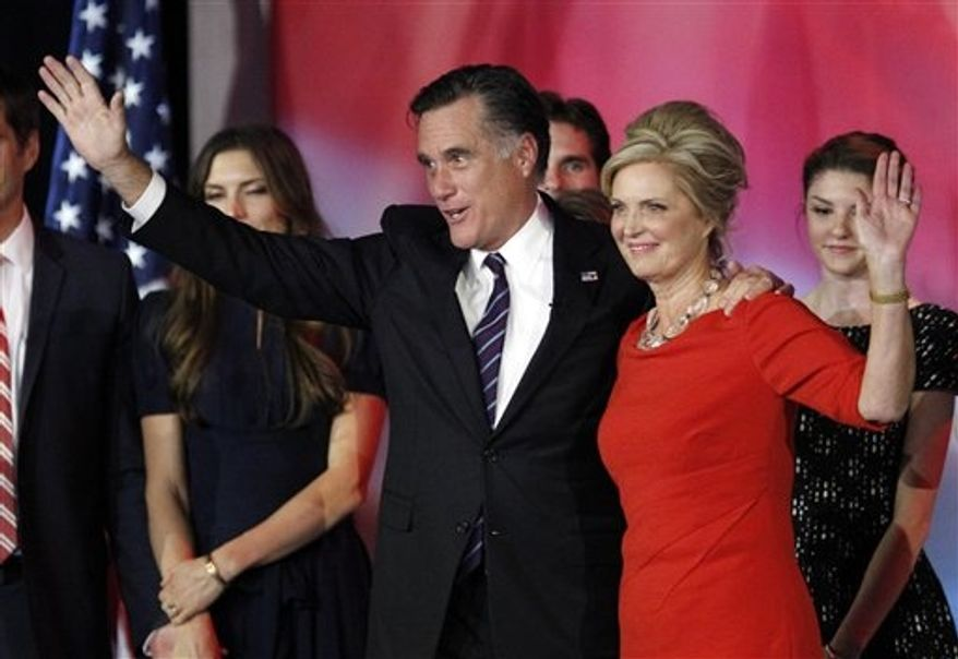 Republican presidential candidate Mitt Romney and his wife, Ann Romney, wave to supporters after Mr. Romney conceded the presidential race at his election night rally on Wednesday, Nov. 7, 2012, in Boston. (AP Photo/Stephan Savoia) ** FILE **