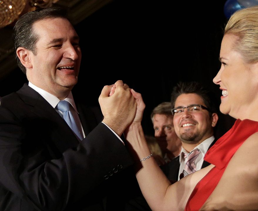 Republican candidate for U.S. Senate Ted Cruz celebrates with his wife Heidi during a victory speech Tuesday, Nov. 6, 2012, in Houston. Cruz defeated Democrat Paul Sadler to replace retiring U.S. Sen. Kay Bailey Hutchison. (AP Photo/David J. Phillip)