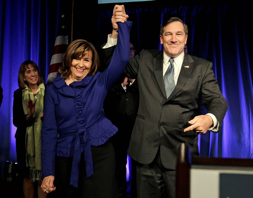 Democrat Joe Donnelly celebrates with his wife Jill after winning the U.S. Senate seat over Republican Richard Mourdock at an election night celebration in Indianapolis, Tuesday, Nov. 6, 2012.  (AP Photo/Michael Conroy)