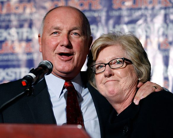 Republican U.S. Senate candidate Pete Hoekstra stands with his wife, Diane, while giving a concession speech, Tuesday, Nov. 6, 2012, in Grand Rapids, Mich. Incumbent Democrat Debbie Stabenow was elected to a third term. (AP Photo/Al Goldis)