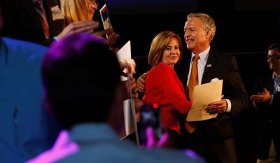 Scott Howell, candidate for U.S. Senate, hugs his wife Linda Howell after he delivered his concession speech during the democrat's election night watch party, Tuesday, Nov. 6, 2012, in Salt Lake City. (AP Photo/Jim Urquhart)