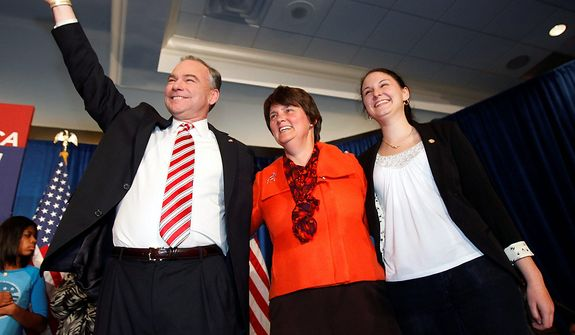 Democratic canidate for Senator-elect Tim Kaine, his wife, Anne Holton, center, and daughter, Annella wave before giving his victory speech in Richmond, Va., Tuesday, Nov. 6, 2012. Kaine also defeated Republican George Allen on Tuesday, keeping both of Virginia's Senate seats in Democratic hands.  (AP Photo/Richmond Times-Dispatch, Bob Brown)
