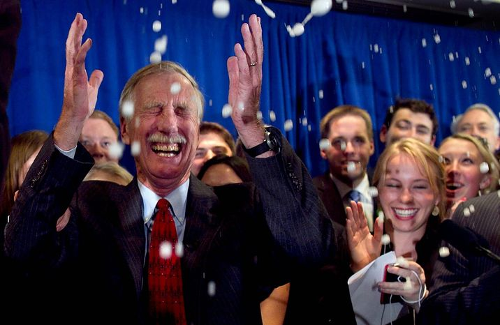 Independent Angus King celebrates under a splash of champagne after winning the Senate seat vacated by Olympia Snowe, R-Maine, Tuesday, Nov. 6, 2012, in Freeport, Maine. (AP Photo/Robert F. Bukaty)