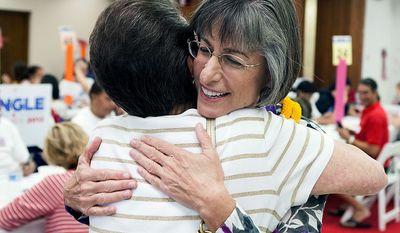 Democratic U.S. Senate candidate Linda Lingle hugs a supporter at her campaign headquarters, Tuesday, Nov. 6, 2012 in Honolulu.  (AP Photo/Marco Garcia)