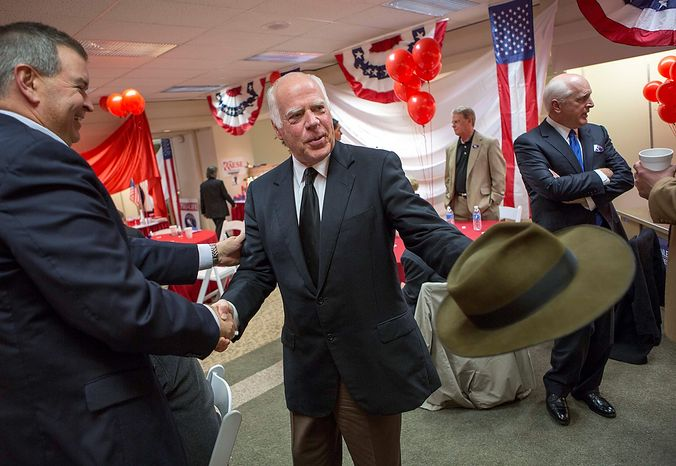 West Virginia senate candidate John Raese greets supporters in Morgantown, W.Va., on Tuesday, Nov. 6, 2012.  (AP Photo/David Smith)
