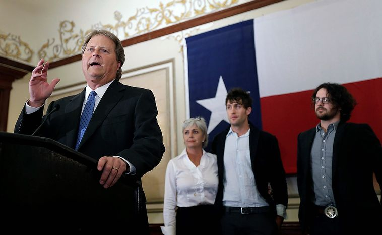 Democratic candidate for U.S. Senate Paul Sadler, left, makes a concession speech at the Texas Democratic Party election watch party, Tuesday, Nov. 6, 2012, in Austin, Texas. With Sadler, from left, are his wife, Sherri, and sons Joel and Lee. (AP Photo/Eric Gay)