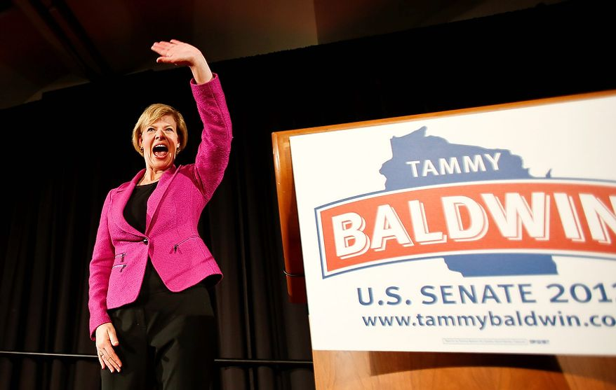 U.S. Rep. Tammy Baldwin, D-Wis., waves to supporters after making her a victory speech Tuesday, Nov. 6, 2012, in Madison, Wis. Baldwin beat former Wisconsin Gov. Tommy Thompson in the race for Wisconsin's U.S. Senate seat. (AP Photo/Andy Manis)