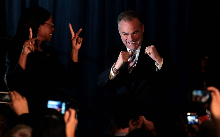 Democratic senate candidate former Gov. Timothy Kaine, celebrates his win over Republican George Allen during his victory party in Richmond, Va., Wednesday, Nov. 7, 2012. (AP Photo/Steve Helber)