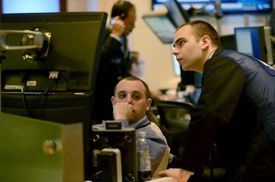 "Traders work on the floor of the New York Stock Exchange the day after Pres. Barack Obama was re-elected, Wednesday, Nov. 7, 2012 in New York. With President Barack Obama elected to another term, U.S. investors dumped stocks Wednesday and turned their focus to a world of problems, including a ""fiscal cliff"" of tax increases and spending cuts at home and a deepening recession in Europe. (AP Photo/Henny Ray Abrams)"
