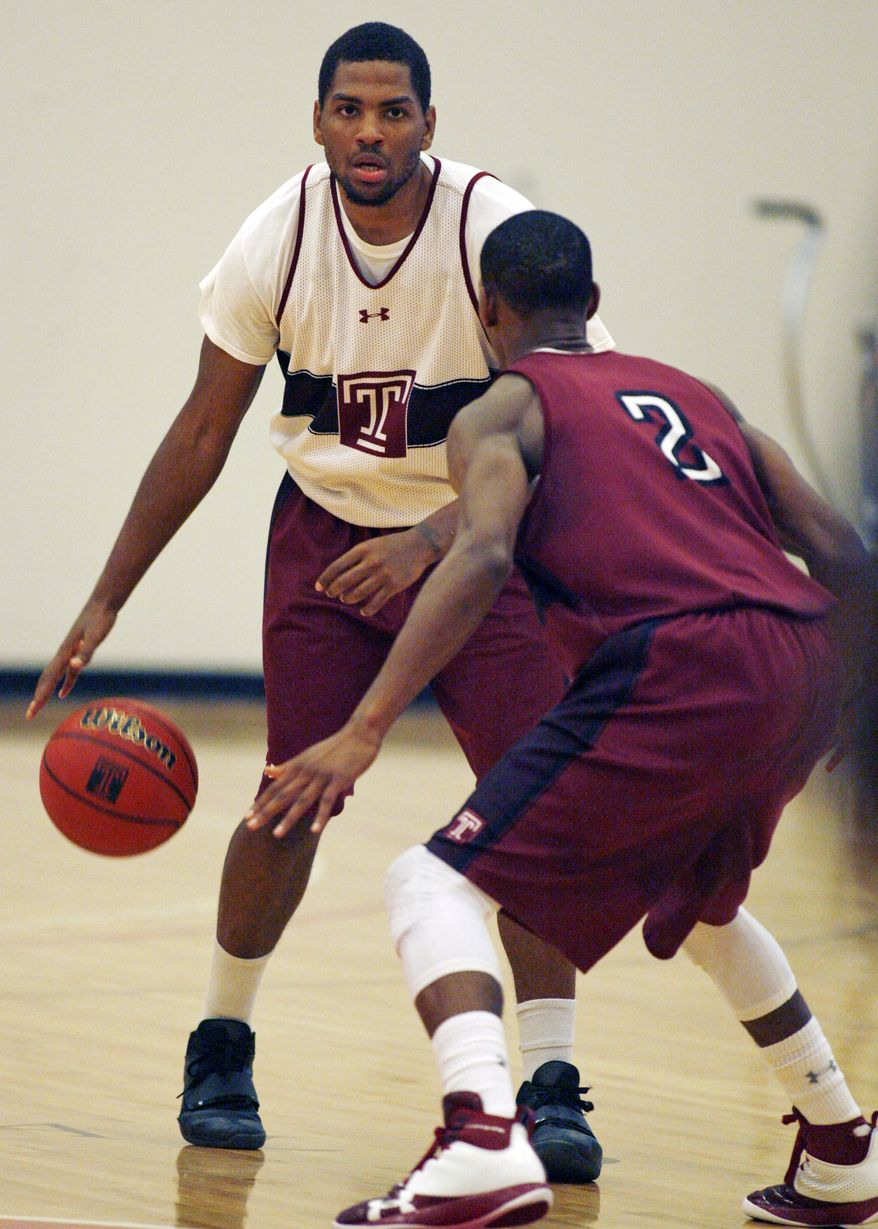 Temple's Khalif Wyatt, left, dribbles while being defended by Will Cummings (2) at practice during their NCAA college basketball media day, Thursday, Nov. 1, 2012, in Philadelphia. (AP Photo/H. Rumph Jr)