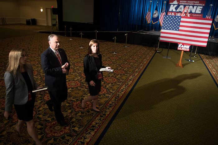 Democratic candidate for Senate Tim Kaine, second from left, does a walk through with campaign aids to get a look at the room where his election night party will be held at the Richmond Marriott, Richmond, Va., Tuesday, November 6, 2012. (Andrew Harnik/The Washington Times)