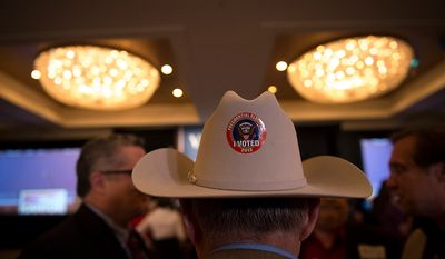 Jay Ipson, of Richmond, Va., wears his vote sticker on his hat at Republican U.S. Senate candidate and former Virginia Governor George Allen's election night party event at the Omni Richmond Hotel in Richmond, Va., Tuesday, Nov. 6, 2012. (Rod Lamkey Jr./The Washington Times)