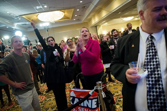 Jill Ward of Richmond, Va., second from right, Nass Era [cq], second from left, visiting from Morocco, cheers as they watch returns on CNN at the Tim Kaine (D) for U.S. Senate election night party at the Richmond Marriott, Richmond, Va., Tuesday, November 6, 2012. (Andrew Harnik/The Washington Times)