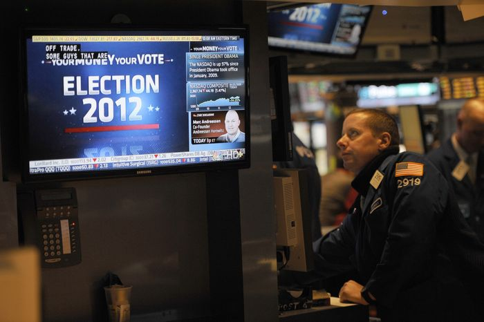 A trader works on the floor of the New York Stock Exchange in New York on Wednesday, Nov. 7, 2012, the day after President Obama was re-elected. (AP Photo/Henny Ray Abrams)
