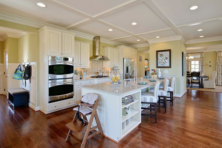 The kitchen has a large center island that can double as a breakfast bar.