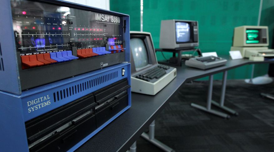 In this photo taken Oct. 30, 2012, an IMSAI 8080 personal computer from 1975 is shown next to other personal computers from the early years of the devices, at the Living Computer Museum in Seattle. (AP Photo/Ted S. Warren)