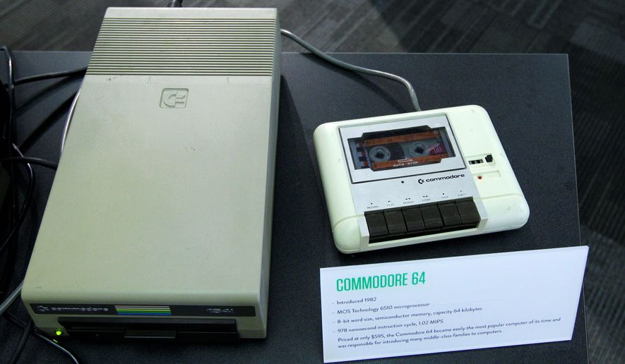 In this photo taken Oct. 30, 2012, a floppy disk drive, left, and a cassette tape data drive for a Commodore 64 personal computer are shown, at the Living Computer Museum in Seattle. (AP Photo/Ted S. Warren)