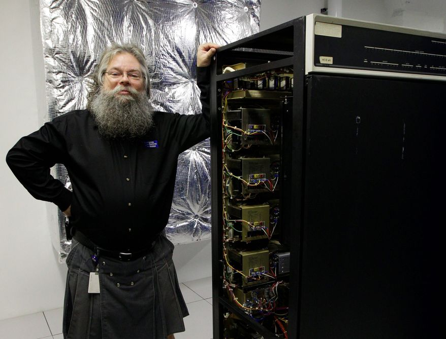 Ian King, senior vintage systems engineer at the Living Computer Museum in Seattle, stands by a memory module of an early 1970s computer with 16 kilobytes of memory. (Associated Press)