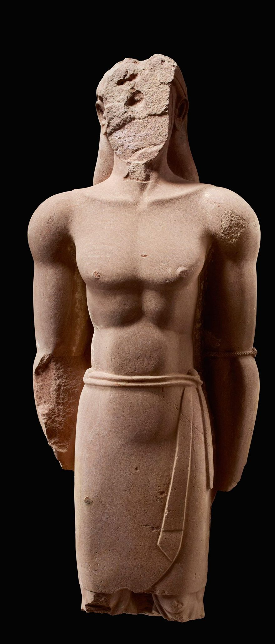 Statue of a man, red sandstone, 4th to 3rd century B.C.