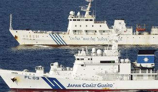 Chinese (top) and Japanese ships steam side by side near islands called Senkaku in Japan and Diaoyu in China, in the East China Sea. Chinese patrol boats have been menacing the Japanese coast guard in an unusually relentless and escalating response to their latest maritime spat. Beijing says the ships from its marine surveillance service are merely defending Chinese sovereignty. (Associated Press)